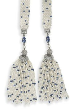 AN EARLY 20TH CENTURY SEED PEARL, SAPPHIRE AND DIAMOND SCARF NECKLACE. The seed pearl and sapphire bead mesh band with similarly-set tassel terminals, to the diamond-set cap, bead and sapphire-set octahedron surmount, 1900s, 96.5 cm.
