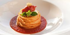 A delicious pasta recipe from Italian chef Giuseppe D'Aquino. Using Piennolo tomatoes, this easy tomato sauce recipe is the perfect accompaniment to spaghetti, burrata and basil.