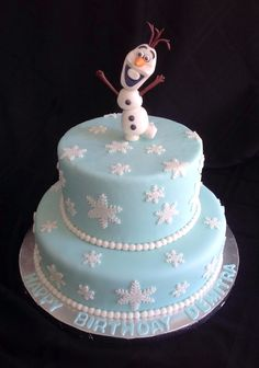 Olaf Fondant covered cake with fondant snow flakes.