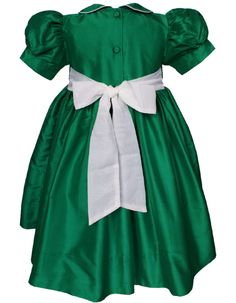 This emerald dress is stunning not only on the front,  but the sash in the back is a statement!