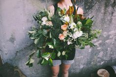 Large Wild Bouquet. Wedding. Greens, Magnolia, Pine, Garden Roses, Lisianthus, Aronia Berry.  www.forestandfieldcreative.com