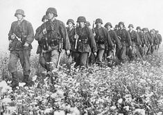 marching Waffen-SS unit crossing a cotton field. Ukraine , Sept. 1941 - pin by Paolo Marzioli