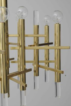 Sciolari Brass & Lucite Chandelier | From a unique collection of antique and modern chandeliers and pendants  at http://www.1stdibs.com/furniture/lighting/chandeliers-pendant-lights/