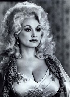 Dolly Parton has the right kind of curves and is a good old country girl, which is why we named one of our tables after her!