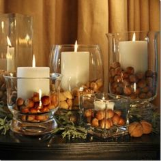 Acorn Candle Decor.  If you are not in an area with acorns a plenty, try an assortments of nuts, or go line cone hunting, small ones would work best (TIP: wear a pair of disposable gloves when gathering pine cones).