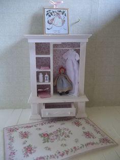 Dollhouse miniature open wardrobe.