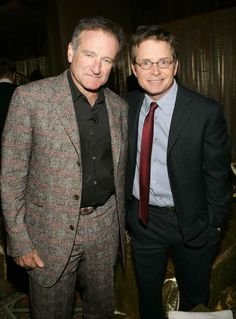 """What would Michael J. Fox say when the news came out that Robin Williams suffered from Parkinson's disease - as does Fox? The two iconic actors are seen here at a fundraiser for Fox' Parkinson concern. MJF Tweeted: """"Stunned to learn Robin had PD. Pretty sure his support for our Fdn predated his diagnosis. A true friend; I wish him peace."""""""