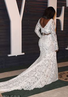 Looking good: The lace garment made the most of Serena's amazing curves and toned physique...