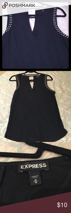 Express knit tank top size M Express knot tank top size medium in blac with gold studs around the arm hole. Features key hole in the front and back. Very comfortable-in great condition. Express Tops Tank Tops