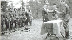 Lithuanian freedom fighter officer awards a female citizen. In 1944-1953 Lithuanian forests sheltered an entire guerilla state with its own government, army and courts of law. Some vainly hoped for Western help, for others tough life in forest helped avoid an even quicker death in Soviet genocide. In order to intimidate the remaining population Soviets used to pubically display guerilla corpses in town squares.