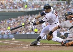 Minnesota Twins' Ryan Doumit grounds to first but an error by Baltimore Orioles first baseman Mark Reynolds allowed him to arrive safely, driving in two runs with the bases loaded off Orioles pitcher Chris Tillman in the first inning of a baseball game Monday, July 16, 2012 in Minneapolis