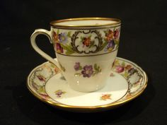 "Each piece is marked ""Bavaria"" with trademark stamp and ""Schumann, Arzberg, Germany"" and ""Empress, Dresden Flowers"" on the base. This beautiful demitassse cup and saucer is decorated with colorful florals on a white ground with gold embellishment. 