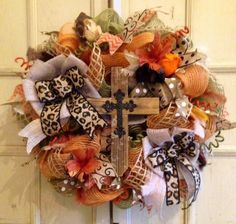 Fall Burlap Wreath. Neat touch with the rustic cross.