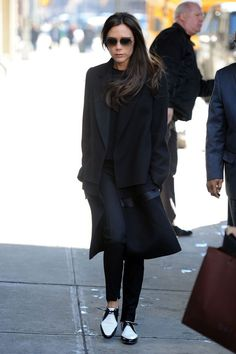 Victoria Beckham imaged on a sunny, cold NYC day in a solitary mood but wearing Spectator Style Flats instead of the usual High Heel Platforms that caused Her painful right Foot bunion.