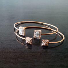 Twin 18K rose gold bracelets studded with D VVS1 diamonds.