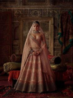 Call/Whatsapp: 7802885280 We are offering Latest Custom Made Collection of Exclusive Bridal Lehenga Cholo in Buy the best collection of bridal outfits at Fabbily Fashion. We have wide variety of Etc.