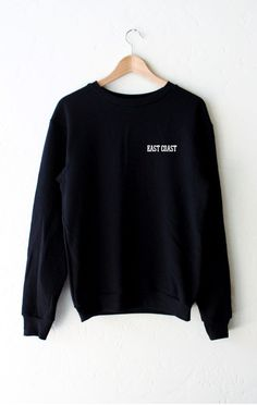 "- Description Details: Oversized crew neck fleece sweater in black with print featuring 'East Coast'. Brand: NYCT Clothing. Unisex/Oversized fit Measurements: (Size Guide) XS/S: 40"" bust, 27"" length,"