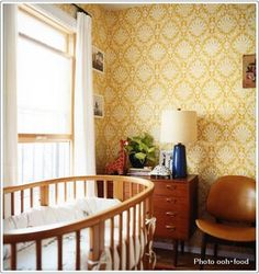 Gorgeous wallpaper in vintage inspired nursery.
