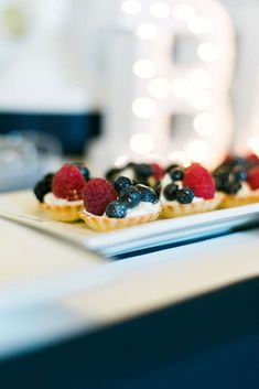 Fruit tarts at a navy and gold baby shower! See more party planning ideas at CatchMyParty.com!