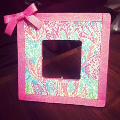 Made this Lilly Pulitzer picture frame for my dorm room! Took a Michael's $1.00 picture frame, mod podge, a printed Lilly pattern, and ribbon. Total cost under $5!