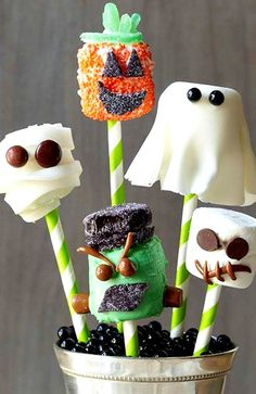 DIY Halloween Marshmallow Pops ~ decorated to look like a skull, mummy, ghost, pumpkin, and Frankenstein. Candy pieces and fondant make each pop unique, while paper party straws give the silly spooksters a place to perch.