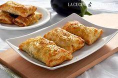 I fagottini melanzane e mozzarella sono uno stuzzicante antipasto. Un semplice scrigno di pasta sfoglia con dentro un gustoso ripieno di melanzane e mozzarella.