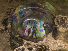 There was a soap bubble on the drain and I saw my picture in it and took a photograph.