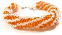 CraftingMemories1 made this Orange and White African Helix Bracelet using the African Helix stitch, white Nymo thread, Silver Lined Halloween Orange Round Japanese Seed Beads and Matte Transparent White Round Japanese Seed Beads attached to a silver toggle clasp. It is approx. 7.5 inches long including clasp.