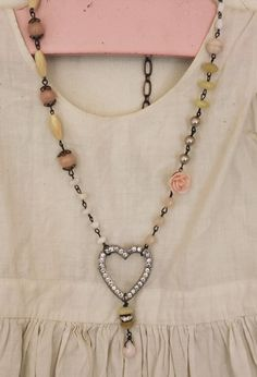 95$-Pink Peruvian Opal, White Jade, old pearls, Peach Aventurine, Yellow Opal, and Mother of Pearl. To finish it off, a dainty faceted pink opal briolette is wrapped around the bead and rhinestone drop.