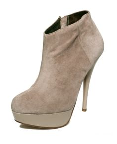 Love that these booties are suede and the top cut is an angle to make the leg look skinny.