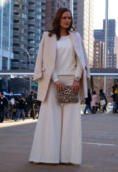 Luxe cream wide-leg pants and printed clutch | Street Style NYFW