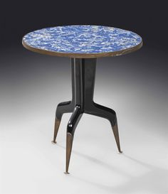 GIO PONTI (1891-1979) OCCASIONAL TABLE, CIRCA 1950 probably executed by Giordano Chiesa, lacquered ebonised wood, brass sabots, lapis lazuli top within brass frame 16¾ in. (42.5 cm.) high; 15¾ in. (40 cm.) diameter