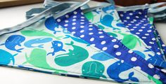 Whales bunting in blue/green fabrics by BagsBunting on Etsy, £15.00