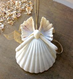 This Butterfly Wing Seashell Angel is handmade here at Sea Things. This Angel is usually white in color. Her Wings are made from a Gorgeous matched pair of Bear Claw Clam Shells. Her backside is shown Seashell Christmas Ornaments, Beach Ornaments, Coastal Christmas, Ornament Crafts, Christmas Angels, Christmas Crafts, Christmas Ideas, Seashell Art, Seashell Crafts