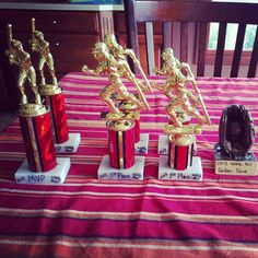 Upcycled baseball trophies for teen boy co-ed wiffleball tournament/birthday party.