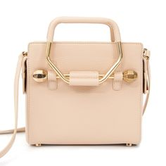 Viktor & Rolf Mini Bombette Bag Nude This Viktor & Rolf handbag with angular metal handles might be petite but it will attract many looks.  Optional, adjustable cross-body strap. Comes with dustbag.