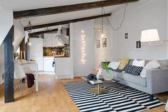 Simple Living Space Applied In Swedish Attic Apartment Equipped With Best Sofa Set Design Equipped With Best Lampshade In White Color. Enchanting Attic Apartment In Bright Impression