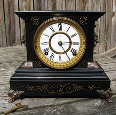 Ansonia mantle clock.....I loved to wind my Grandparents clock like this.