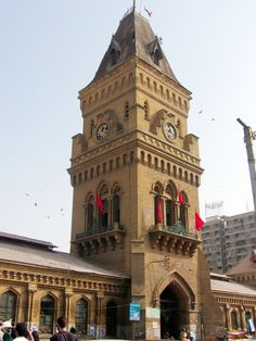 Entrance to the Empress Market in the Saddar Town of Karachi, Pakistan.  The market traces its origins to the British Raj era and it was the British that built this marketplace.  Today is is amongst the most popular and busy places to shop in Karachi.  The market was named after Queen Victoria, Empress of India during the Raj era. Commodities sold in the market range from condiments, fruit and vegetables to meat, stationary materials and textiles.