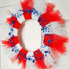 Welcome your 4th of July guests with this festive tulle wreath! More 4th of July crafts for kids: http://www.bhg.com/holidays/july-4th/crafts/patriotic-crafts-for-kids/?socsrc=bhgpin062913tullewreath=4