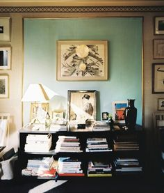 from lonny: frame a large piece of paper & then hang art in front of it; or affix picture molding to the wall & then paint interior