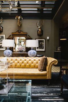 yellow tufted sofa looks great in this room.