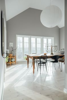 my scandinavian home: A Light-filled, Pared-Back Coastal Home In Halland, Sweden. Dining room featuring a vintage table a mismatched dining chairs. White Wash Walls, Swedish Interiors, Interiors Magazine, Kitchen Cabinet Styles, Nordic Design, Coastal Homes, Scandinavian Interior, Minimalist Home, Decoration