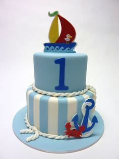 This cute little nautical cake design  was inspired by the plates and napkins that were purchased for the birthday boy's party. Thanks for looking!
