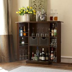 The Beekman fold-away compact bar by angelo:HOME saves space without sacrificing functionality. This cabinet-style bar conceals your liquor stash until it's time to entertain guests. Espresso-colored wood gives this bar a sophisticated look when closed.