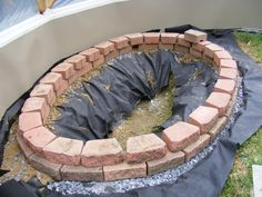 Build this simple, above ground pond ideas in a weekend. It features a fountain and a trellis.