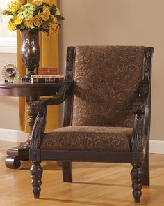 Paying tribute to classic styling, the Bradington Accent Chair is marked by its distinctive high back, comfortable low-slung seat and regally detailed frame. Luxurious tapestry upholstery furthers the refined look.