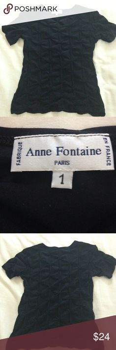 """Anne Fontaine France Casual Black Top Size 1 Cute black casual top by Anne Fontaine. Made in France. Size 1. Fabric content tag is faded, but this feels like a stretchy nylon or polyamide blend - it's not a cotton t-shirt. All-over 'pinch' detail. Approximate measurements: pit-to-pit = 14"""", length = 19"""". Gently worn (care/content tag is worn, but shirt is in great condition). Anne Fontaine Tops"""