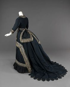 """Half-Mourning Dress: 1872-74, American, silk. """"This half mourning dress shows the care with which additional colors were implemented in mourning attire with the white accents carefully placed to not overwhelm the black and create a visually appealing transitional garment."""""""