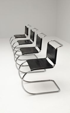 A set of four chromed steel frame Mies van der Rohe chairs with sling back and seat. The seats, backs are original saddle black leather. City Furniture, Vintage Furniture, Furniture Decor, Furniture Design, Estilo Tropical, Cantilever Chair, Upholstered Swivel Chairs, Ludwig Mies Van Der Rohe, Home Office Chairs
